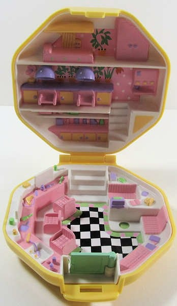 I had the Polly Pocket hair salon... and I LOVED IT SO MUCH!