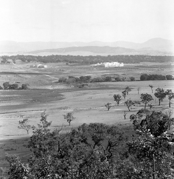 Mildenhall's Canberra, 100 years ago - Australian Geographic. 1 January, 1927. Parliament House and East Block from Russell Hill. Canberra was established largely in sheep paddocks in 1913.