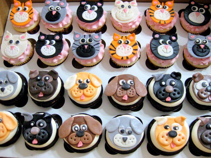 Cat & Dog themed fondant cupcake toppers..via Sweet Dreams Cupcakery