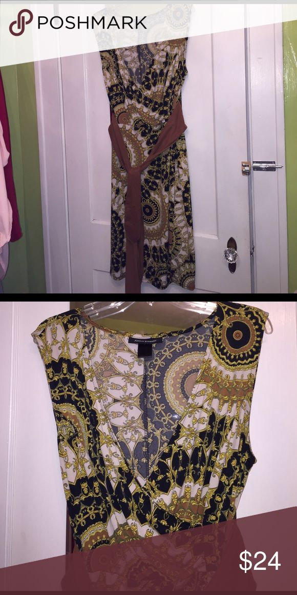 Ashley Stewart Plus Size Dress Sz 16 Ashley Stewart Plus Size Dress Sz 16. Very eclectic style dress. I paired it with some camel colored Suede knee high boots. Perfection...👌 reminds me of a 70's style dress. This beauty will hit at the knee. Thin material, very comfortable. Ashley Stewart Dresses Midi
