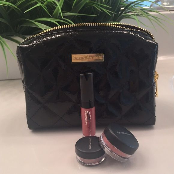 Bare Minerals Set Brand new Bare Minerals gift set. Marvelous Moxie lip gloss in Spark Plug, eyecolor in Heart, and blush in Aubergine. Comes with a black quilted makeup bag with the plastic still covering the logo. No tags but all the makeup is unopened. bareMinerals Makeup