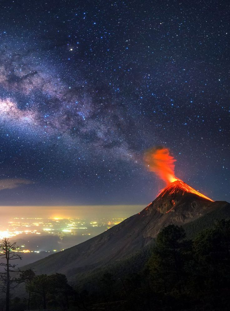 A photographer has captured incredible pictures of a Guatemalan volcano erupting – and he even managed make it look like it was shooting the Milky Way out.    Albert Dros camped out under the stars in order to get the perfect shot of Fuego Volcano in Guatemala mid eruption.