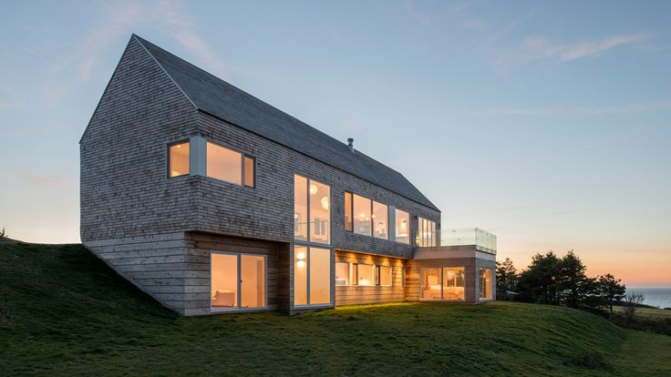 Sitting atop a hillside adjacent to the Inverness Harbour and MacIsaac's Pond, the cedar clad minimalist gable overlooks the town of Inverness and the critically acclaimed Cabot Links golf course. From the main road the home is presented as a single storey with a perpendicular garage. From the opposite side, falling down the hill is …