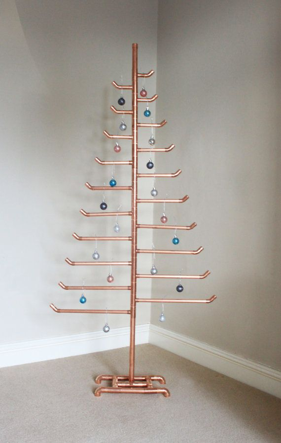 Deck the halls with copper pipe this Christmas with the Hyland & Boot Christmas tree.  Who says Christmas has to be traditional? Add an industrial, minimalist feel to your festive decoration with this rose gold coloured copper tree.  Measuring 146cm tall, its sure to make an impression and is quick and easy to assemble, with no tools required, meaning your home can be looking festive in no time.  The branches can be slotted in to the tree and re-arranged however you wish, allowing you to ...