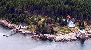 aerial view of lighthouse and buildings