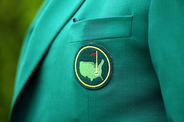 Masters logo is seen on the jacket of a member during a practice round prior to the start of the 2015 Masters Tournament at Augusta National Golf...