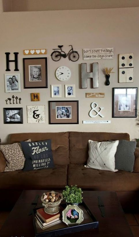 family picture wall neutral colored gallery wall with assorted frames and odd bits note