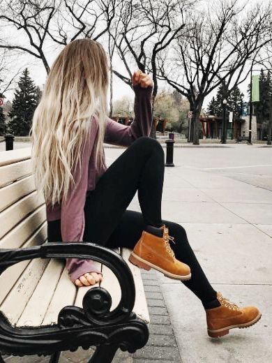Timberland boots, leggings, and a cozy sweater.