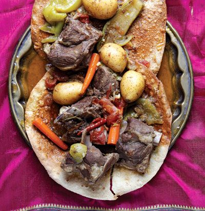 Tharid (Emirati Lamb Stew): Often referred to as the Prophet Muhammad's favorite dish, this satisfying lamb and vegetable stew is served over thin, cracker-like bread called regag to soak up the rich juices.