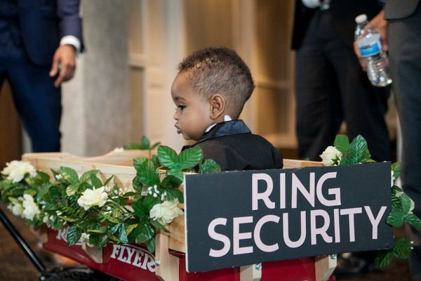 "Cute ring bearer idea - ring bearer rolled down aisle in a wagon decorated with ""ring security"" sign  {Bellagala}"