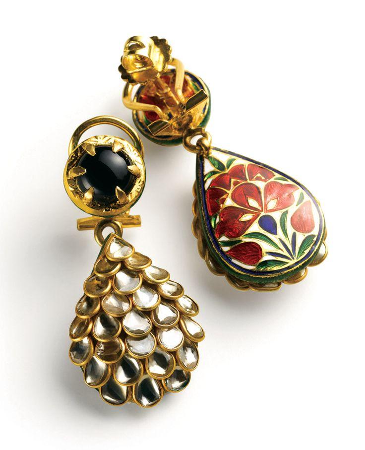 Earrings- Polki earrings with semi precious stones and elaborate meenakari on the backside. (Uncut flat diamonds, semi-precious stones and enamel in 22k yellow gold)