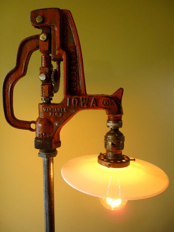 This great vintage industrial lamp was made from an old water pump. The pump has wonderful text that is highlighted from the orange paint