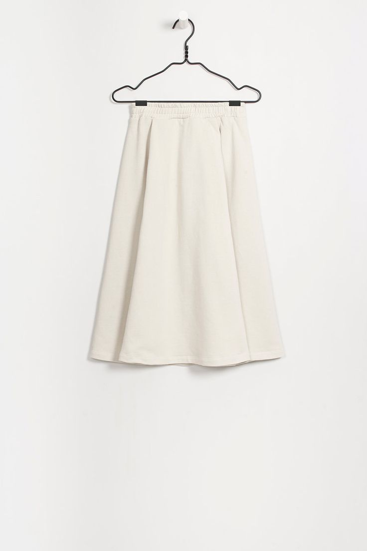 Panelled skirt with elastic waistband & front pockets concealed under pleats. Made from premium 100% certified organic fair trade…