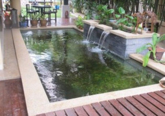 Koi pond construction design proper bioligical for Fish pond fountain design