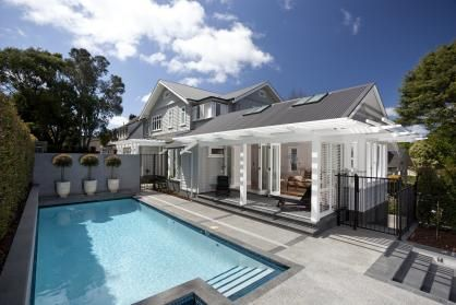 A pavilion-style addition to this elevation accommodates a pool room, which can also be a teenager's retreat.
