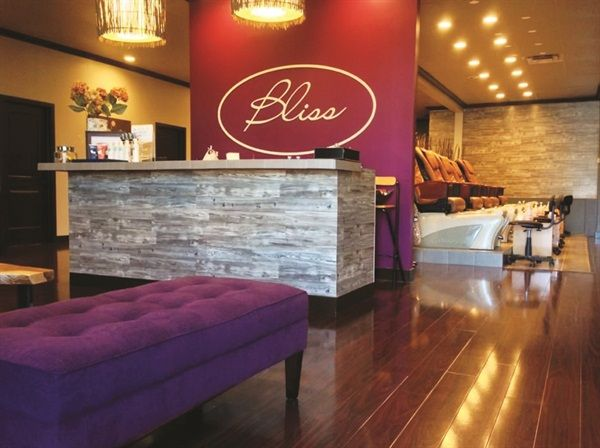 Bliss brightened up the salon decor in 2014, and added purple accent walls.