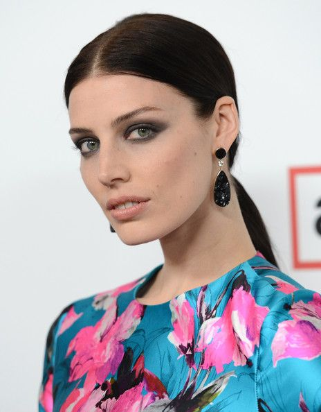 Jessica Pare Ponytail - Jessica Pare kept her hair sleek and straight with this low ponytail.
