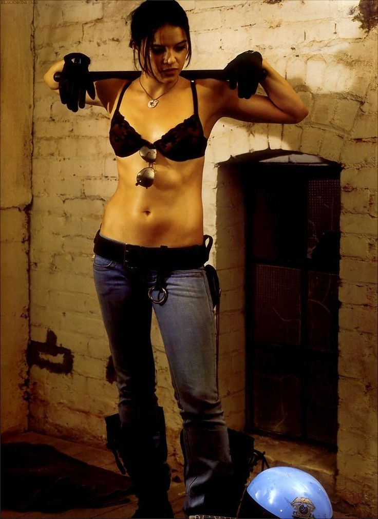 Michelle Rodriguez; a beautiful woman. Also loving the fact that she isn't a size 0 and can lift more then a feather. I like tiny girls but every once in a while I need one who can kick ass.
