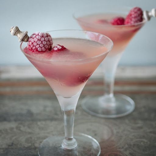 Raspberry Lemon Drop Martini With Ice, Fresh Lemon, Raspberry Flavored Vodka, Absolut Citron Vodka, Cointreau, Lemonade, Fresh Raspberries