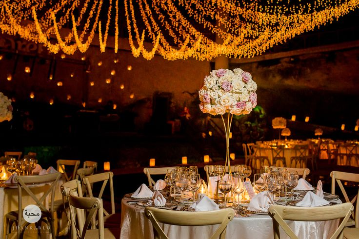 Beautiful wedding tables and flowers at Xcaret, Riviera Maya by #JhankarloPhotography