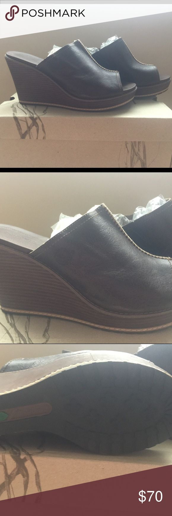BNWOT Timberland Espresso Wedge Slides, Sz 9 BNWOT Timberland Espresso Wedge Slides, Sz 9. Purchased from Zappos in 2015 and never worn because I hurt my back. 😔 Can no longer wear heels...my loss is your gain. Super cute and great w skinny jeans or shorts or whatever. Color is dark brown and heels approx 3 inches. No longer available on Zappos or Timberland website. Box provided but not original box. MSRP: $130 Timberland Shoes Mules & Clogs