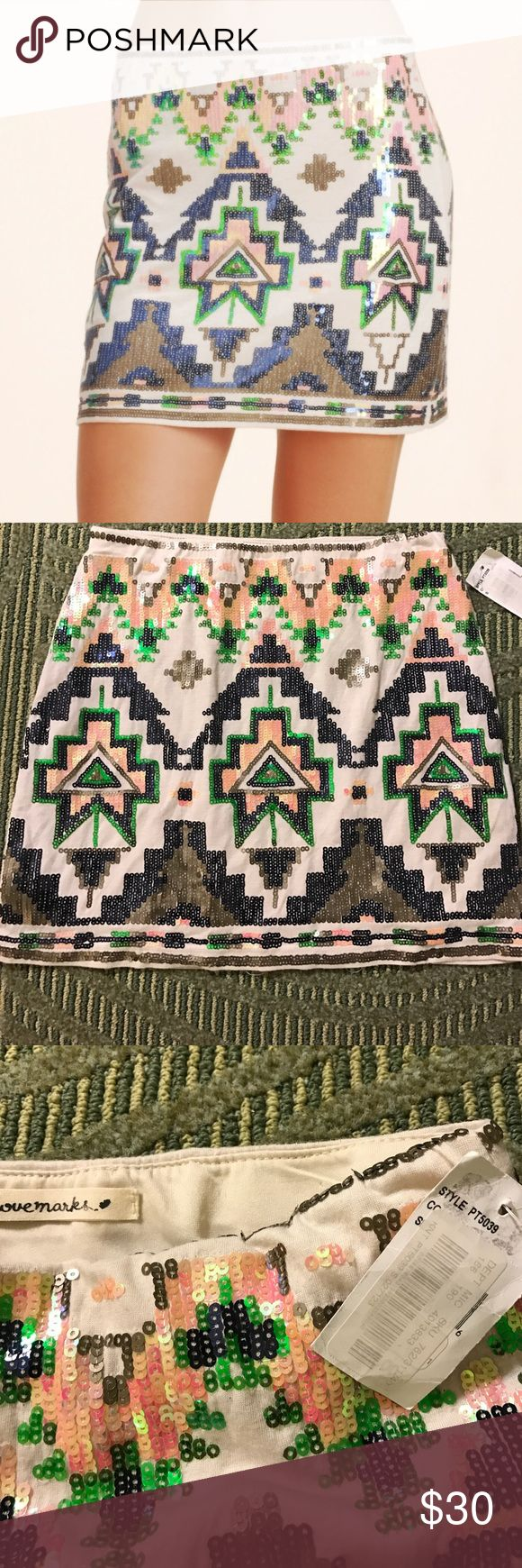 🍑NWT LOVEMARKS🍑AZTEC SEQUIN SKIRT🍑 This is a stunning mini by the brand love marks sold Dillard's. New with tag no flaws no missing sequins. Pull on. You can wear it with tights leggings bear legs however you please rock it with pride. Fully lined Shell is 100% rayon lining is 100% polyester. Rubber waist. Waist 12 1/2 inches without stretch, hips 15 1/2 without stretch, length 13 1/2 Skirts Mini