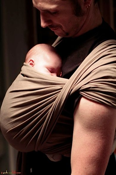 proper baby wearing in several positions and ages - great reference guide
