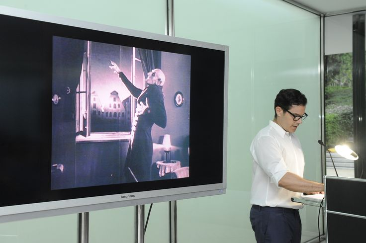 """Spyros Papapetros talking about """"Malicious Houses"""" at the Mies Pavilion http://www.fundacionhannefkens.org/wp-content/uploads/2015/07/15.07.22NefkensMaliciousHousesSpyros027.jpg"""