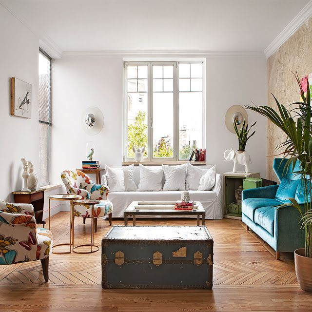 a beautiful house in Madrid, bright and bold colors for the living room, modern cosy style • the Round Button blog