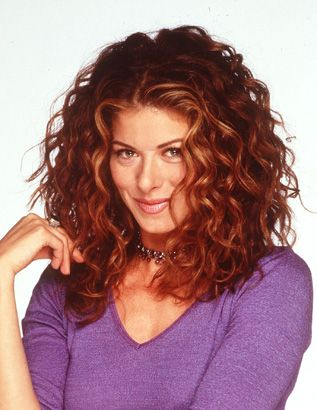 Dark Red Curly Hair | Debra Messing with brown-red hair color with cool skin tone