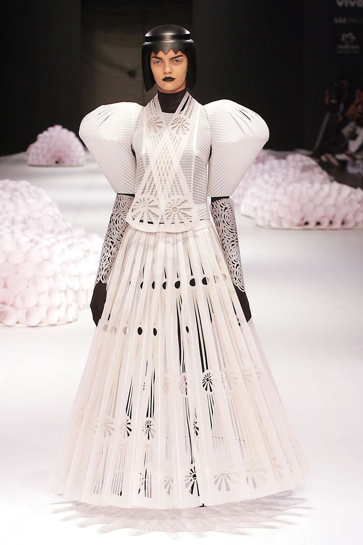 Jum Nakao's dresses in his 2004 collection were crafted entirely out of paper, an idea that sparked Irina Kruzhilina's interest.