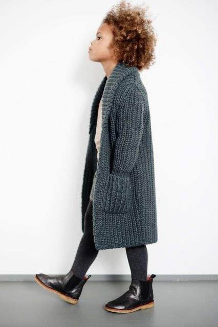 Love this long chunky knit cardigan. It's a great girls autumn look. She knows she's cool.