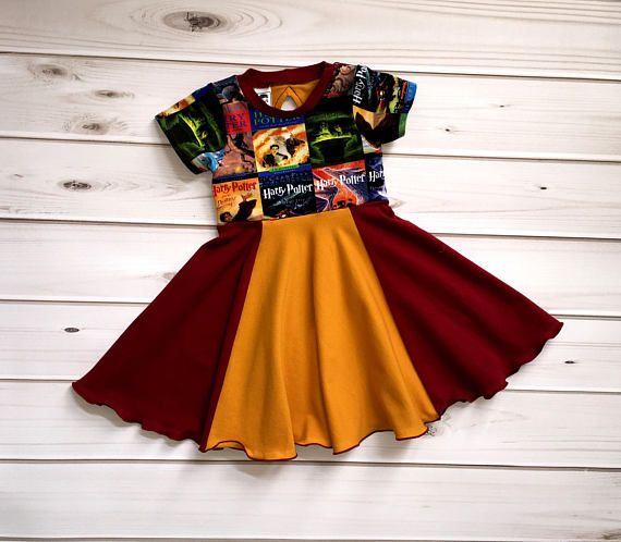 Size 3T  Your little one will celebrate their inner wizard with this twirly dress inspired by the house of Gryffindor!  The bodice is made with Harry Potter cover art custom fabric, 95% cotton 5% Lycra.  The skirt is made using Gryffindor house colors, to show your bravery and sense of adventure!  Need a different size? This item is available for custom order, just send me a message! Custom order turn around times are usually about 2 weeks (meaning you will receive a shipping notification…