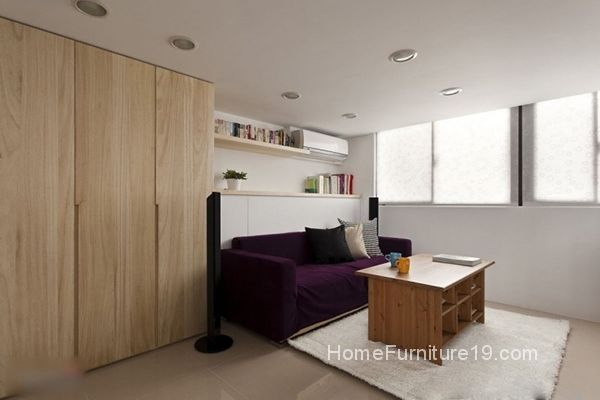 Purple Colored Soft Sofa Brown Wooden Cabinets And Colorful Pillows