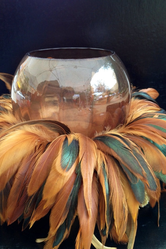 add feathers to the candle holder