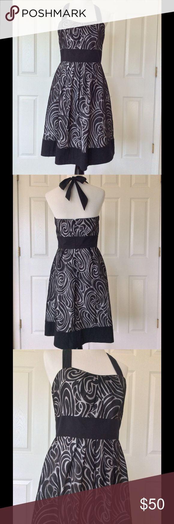 "🆕Listing WHBM Dress Beautiful halter style with shimmery black overlay with black hemline, waist and straps over a white lining. Tucking on bodice and skirt. Hidden back zipper. Rayon & polyester shell' cotton trim, acetate lining. Dry clean. Excellent pre-owned condition. Worn once. Bust 34"", empire waist 29"", hip up to about 47"", length from top of bodice 33"" 🎀Bundle discount  🚭Smoke free home 🚫No trades please  😍 Thank you for shopping with me. Please ask all questions before…"