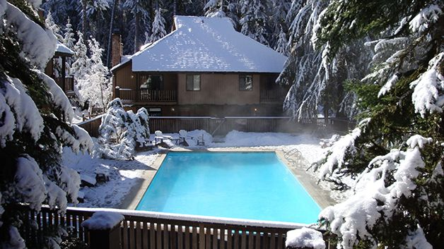 Alta Crystal Resort: the pool is heated! Named one of the Top 10 National Park Lodges by Travel & Leisure. Also recommended by AAA 3-diamond, Best Places Northwest,Trip Advisor, Fodors, Frommers & more….  Come stay among 150-foot tall firs at Mt. Rainier's Sunrise entrance. Our small resort is located on 22 acres in the national forest, with miles of hiking and biking trails from your door. Charming chalet suites and a romantic honeymoon log cabin. #visitrainier #mountaingetaway