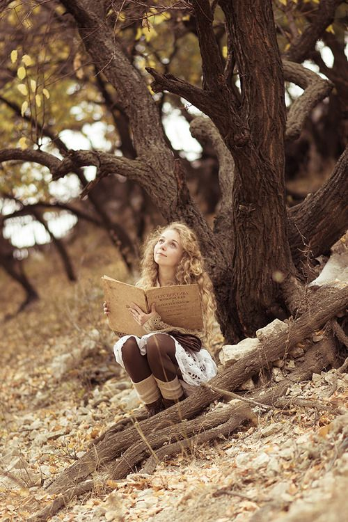 """Aria grinned, clutching her book. """"It's my favorite."""" She sighed. """"Would you like to read it?"""" I nodded. She patted to the root next her, silently ushering me to come sit. """"Once upon a time...."""" She began. I couldn't help but stare at her Sun-lit face glowing from the reflection of the book."""