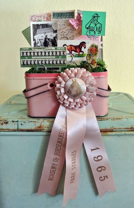 "Sweet Vintage Lunchbox Lined With Moss, Planted With Ephemera Pieces, and ""Showed-Off"" By a Vintage Horse Ribbon"