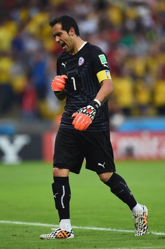 Chile 2 España 0 (6.18.2014) - El Nuevo Herald Claudio Bravo of Chile reacts after his team's first goal during the 2014 FIFA World Cup Brazil Group B match between Spain and Chile at Maracana on June 18, 2014 in Rio de Janeiro, Brazil. Matthias Hangst / Getty Images