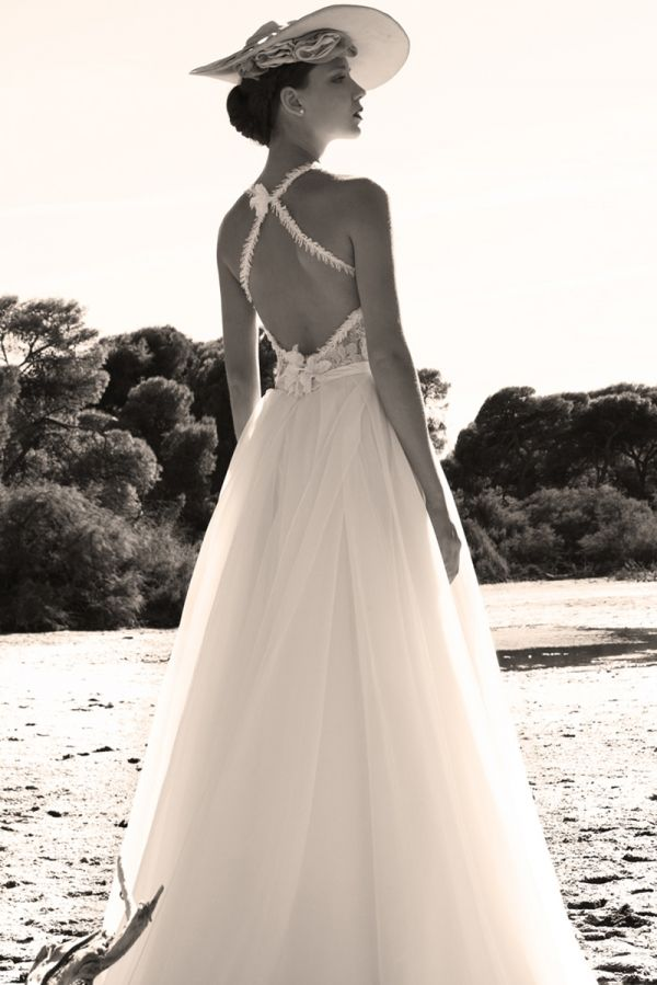 Silk layered slit skirt combined with a Chantilly lace bustier with appliqué flowers