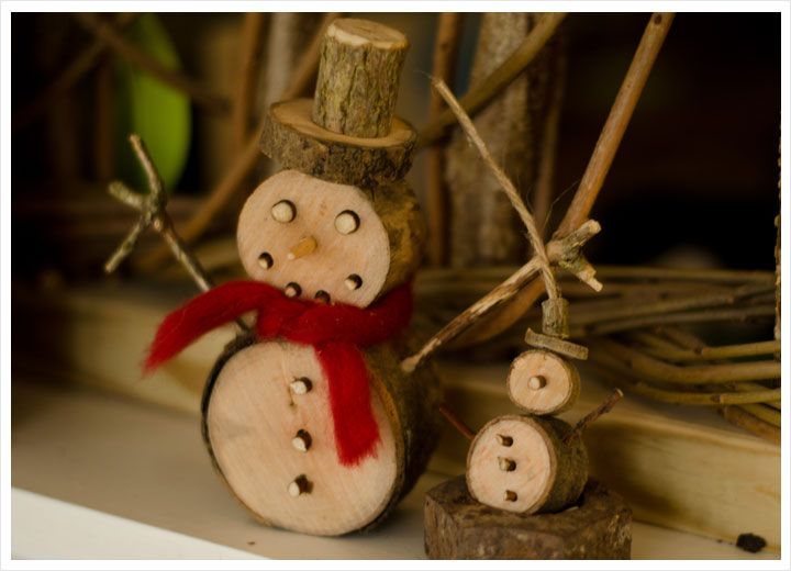 Wooden Snowmen from cut branches and sticks.