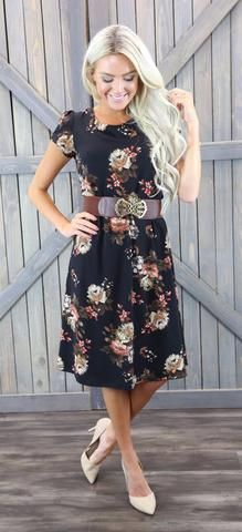 This black floral dress looks great on all body shapes. The Cassie has cap sleeves and is gathered at the waist. Would look great with a belt. 100% Polyester Handwash cold, lay flat to dry. -