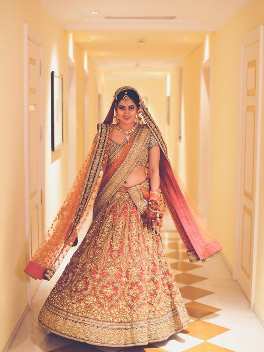 Stunning peach and teal sabyasachi lehenga