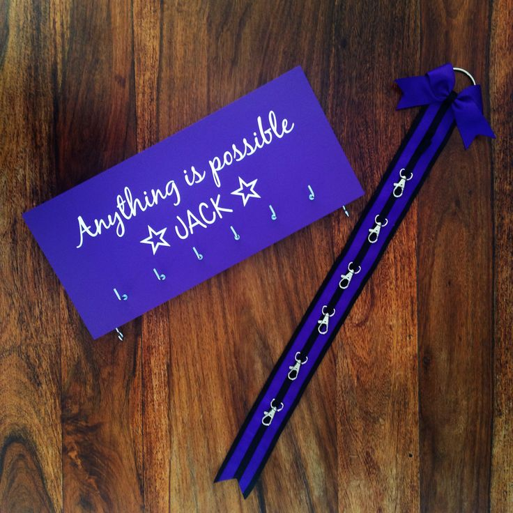 Purple personalised medal holder and bow holder set.