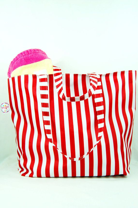 This Red Stripe Beach/Tote bag is waterproof, lightweight and perfect for using at the beach, swimming or just carrying your shopping.  The bag comes with a deep an internal pocket made from matching material and is closed with a zipper to secure valuables.  The strap is 55cm so can be carried over the shoulder. Strap length can be altered to be carried in hand, please let me know required length.   Made of durable Ripstop PVC fabric, the bag is shower proof and wipe clean.  Each bag is ...