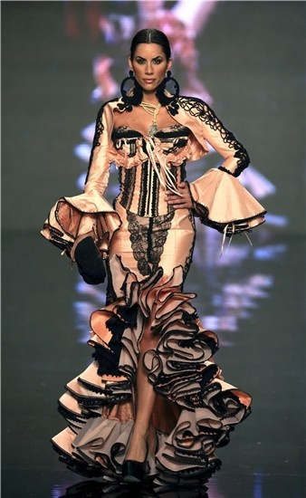"Eva González models a dress inspired by Goya bullfighting | Virginia Herrera runway presentation, ""Alternativa"", at the International Flamenco Fashion Show (Salón Internacional de la Moda Flamenca (SIMOF)), 2013"