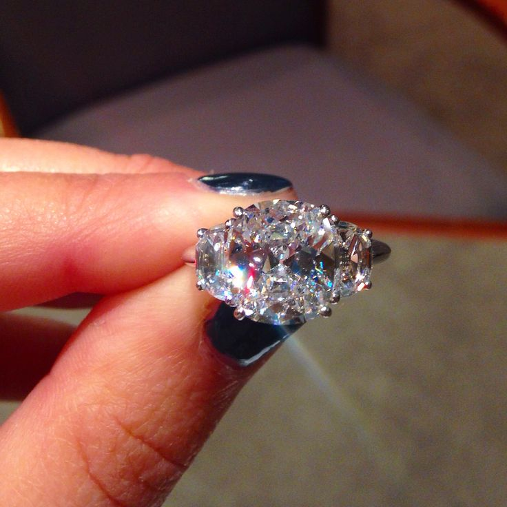 Trabert and Hoeffer cushion cut diamond, three stone engagement ring.