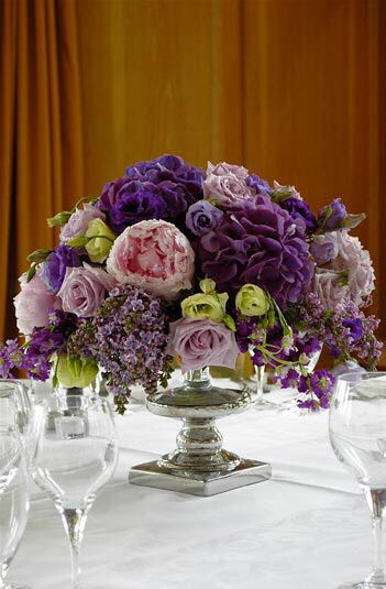 Low purple centerpieces with emerald green and silver mercury glass...take out the pink and add more pops of green...for Friday night in Forsyth Park