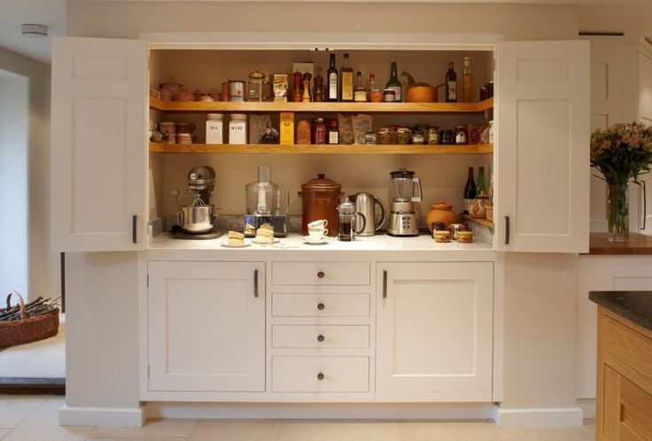 Larder cupboard designed by Giles Slater for Figura. A large larder cupboard within the wall with generous bi-fold doors revealing marble and oak shelving. A workstation and ample storage area for food and appliances. (click on the image for a larger version on our website)